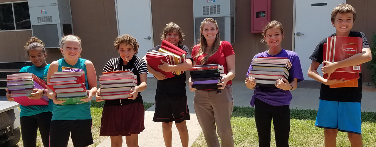 Students Holding Textbooks
